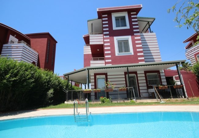 Triplex Home with a Private Garden and a Pool in Belek